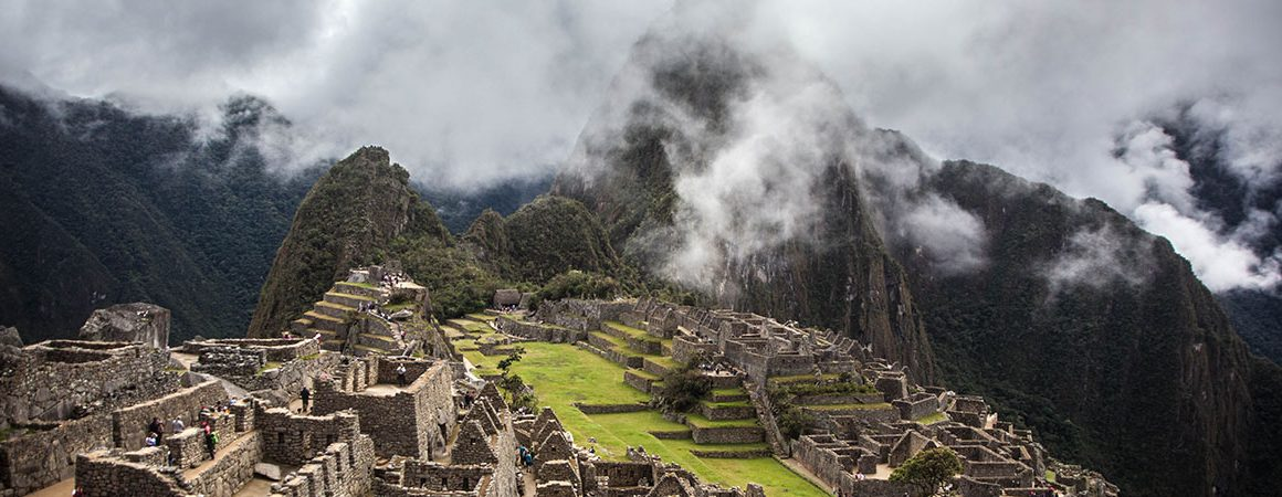 Machu Picchu ruins floating in misty clouds