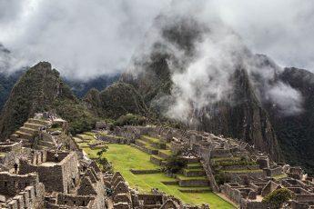 Machu Picchu ruins floating in misty clouds