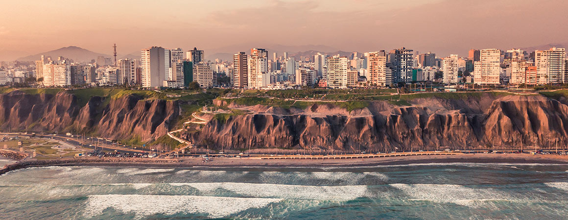 city coastline of Lima with a rose colored sky