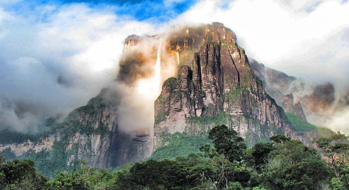 A beam of light illuminates the cascading Angel Falls in Venezuela.