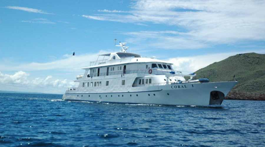 The Coral I, a yacht offering Galapagos luxury cruises, making its way through the water.